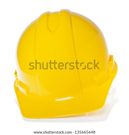 Frontal view of two hard hats, yellow on top of white, isolated on white background.