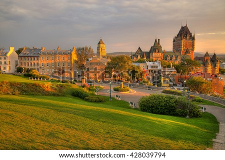 Frontenac Castle in Old Quebec City in the beautiful sunrise light. High dynamic range image. Travel, vacation, history, cityscape, nature, summer, hotels and architecture concept - stock photo