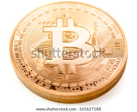 frontside of a bitcoin coin - bit coin BTC the new virtual money - stock photo