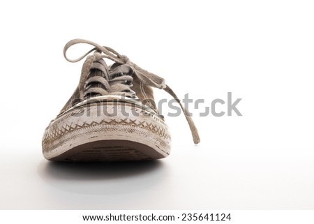 Frontview of old dirty sneaker - stock photo