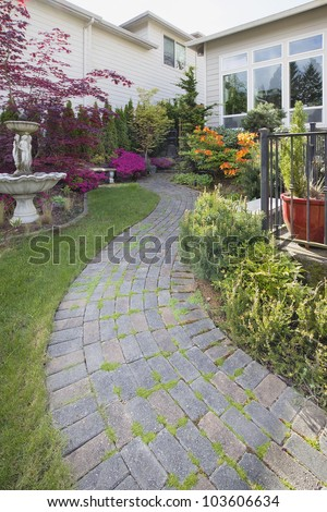 Frontyard Cement Stone Paver Path on Green Lawn with Water Fountain Vertical