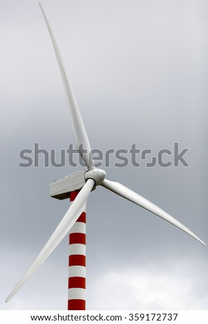 FROSOLONE, ITALY - 29 JULY 2014: Wind turbines standing on a hillside at a wind farm in Frosolone.