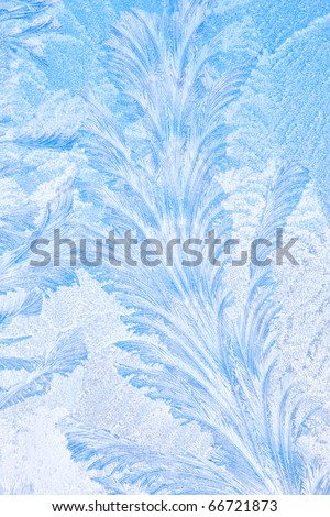 Frost forms in patterns on window glass on a cold winter morning