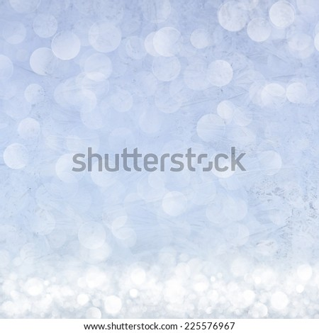 Frost patterns on window. Festive bokeh background