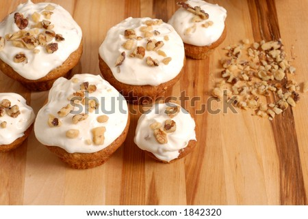 Frosted banana walnut muffins with chopped nuts