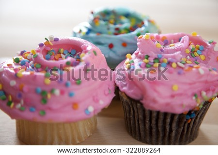 Frosted cupcake desserts - stock photo