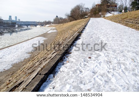 frosted walking trail along the river city a cold winter day  - stock photo