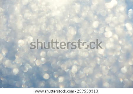 Frosty bokeh glitter sparkle abstract background with defocused lights