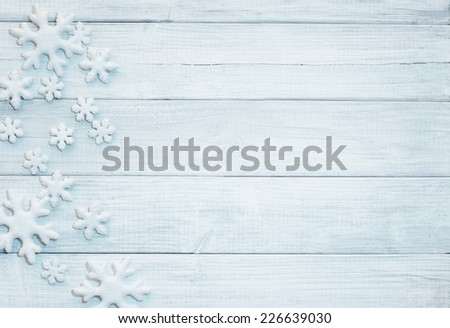 Frosty 3D Snowflakes on Rustic Wood Board Background with empty room or space for copy, text, your words.  Horizontal blue tone white or gray - stock photo
