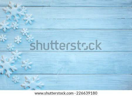 Frosty 3D Snowflakes on Rustic Wood Board Background with empty room or space for copy, text, your words.  Horizontal bright blue - stock photo