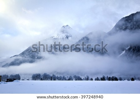 frosty foggy mountains - stock photo