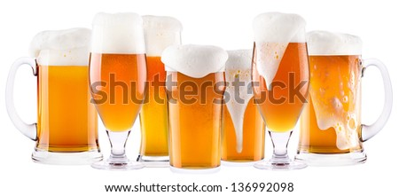 Frosty fresh beer collection with foam isolated