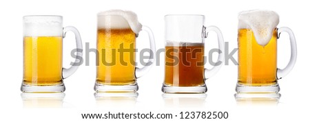 Frosty fresh beer set with foam isolated - stock photo