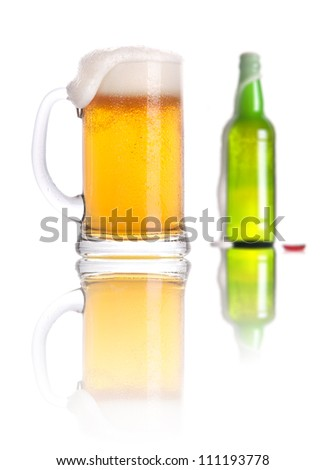 Frosty glass and bottle of beer isolated on a white background - stock photo