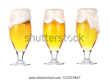 Frosty glass of beer with foam isolated on a white background