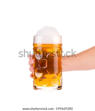 Frosty glass of beer with hand. Isolated on white - stock photo