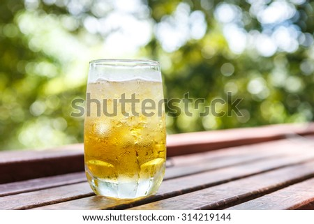 Frosty glass of light beer  - stock photo