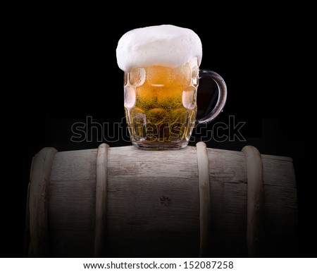 Frosty glass of light beer  isolated on a black background - stock photo
