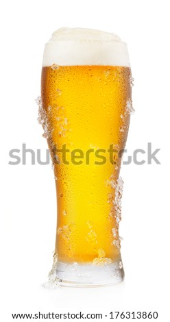 Frosty glass of light beer isolated on a white background - stock photo