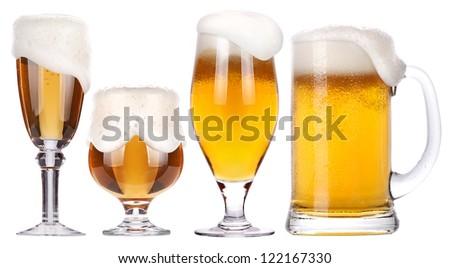 Frosty glass of light beer isolated set on a white background - stock photo