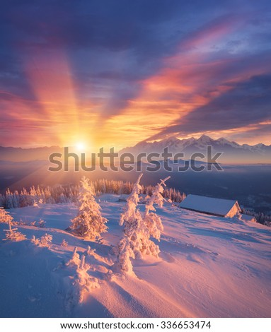 Frosty morning in mountains. Colorful sunrise. Winter landscape. Christmas view - stock photo
