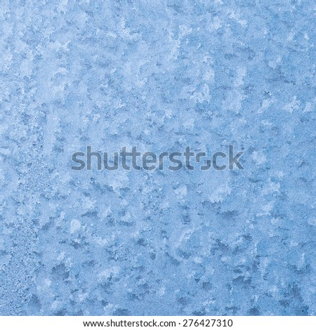 Frosty natural pattern on winter window. - stock photo