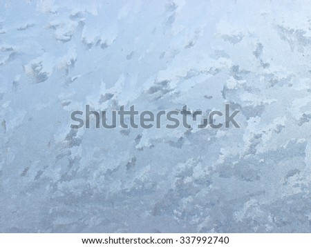 Frosty natural pattern on winter window - can be used as a background.