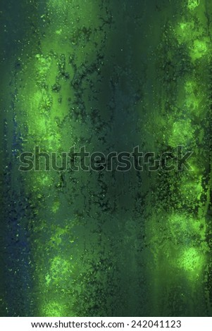 frosty pattern on the glass against the green lights