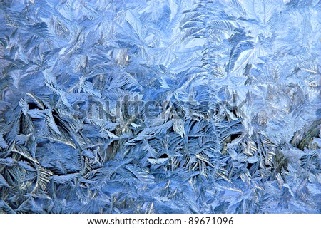 Frosty pattern on window glass surface - stock photo