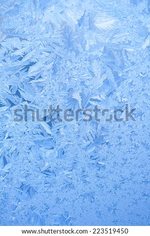 Frosty pattern on winter window - stock photo