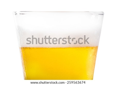 Frosty pint glass of beer isolated on a white background - stock photo
