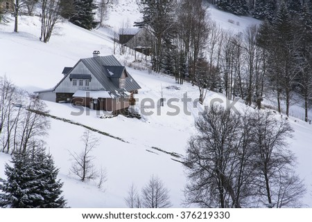 Frosty snowy country with houses in a sunny winter day - stock photo