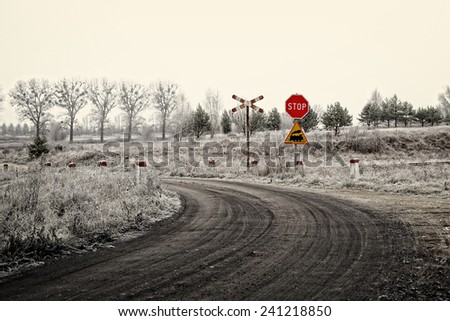 Frosty winter landscape with trees and train crossing - stock photo