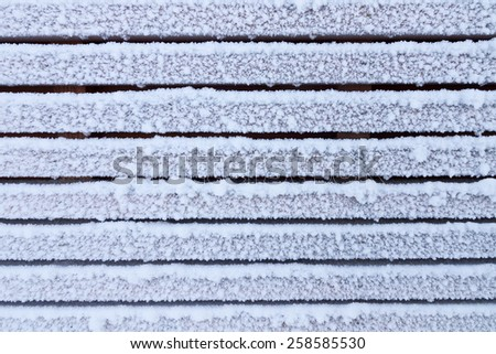 Frosty wooden wall - abstract winter background - stock photo