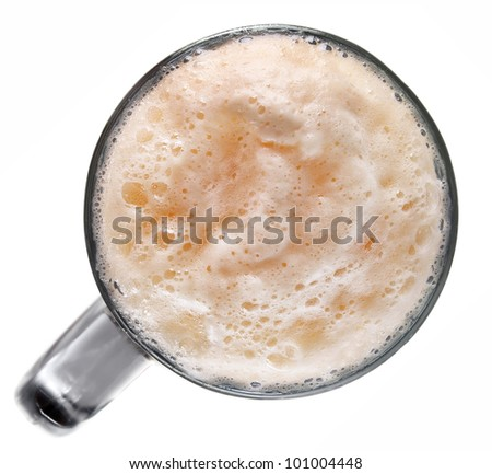 froth dark beer in glass isolated on white background