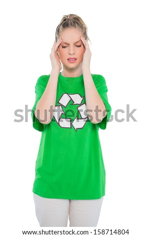 Frowning blonde activist wearing recycling tshirt posing on white background - stock photo
