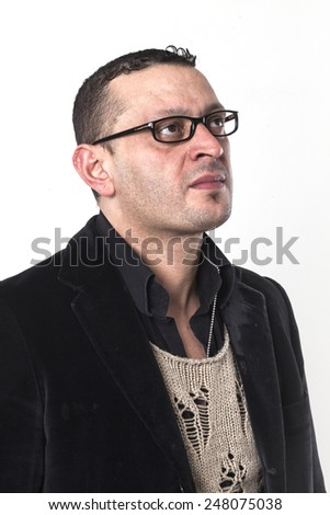Frowning man wearing glasses and looking aside - stock photo