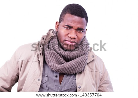 Frowning man with brooding expression - stock photo