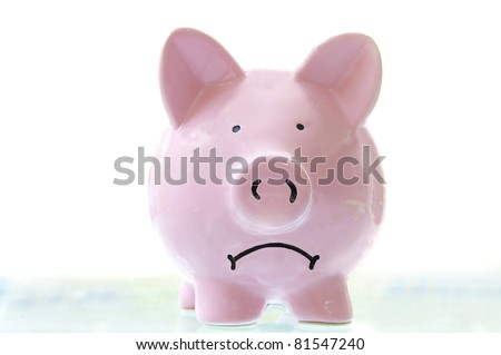 frowning pink piggy bank, on white - stock photo