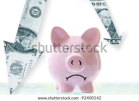 frowning pink piggy bank with downward pointing dollar arrows - stock photo
