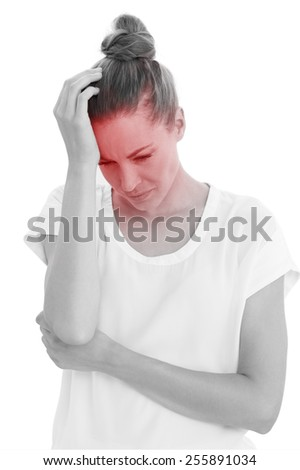 Frowning woman with a headache on white background