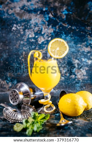 frozen alcoholic cocktail, refreshment drink with vodka and lemons served at bar - stock photo