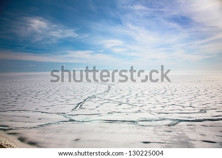 frozen baikal lake in winter - stock photo