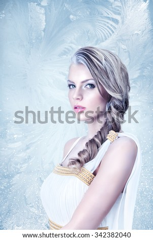 Frozen beautiful young woman fashion winter portrait - stock photo