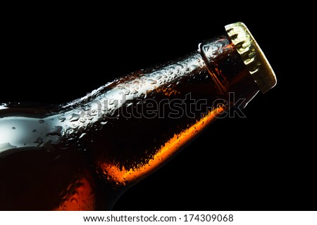 frozen beer bottle isolated on black background , saved clipping path