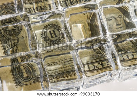 Frozen bill as a symbol of bad investment - stock photo