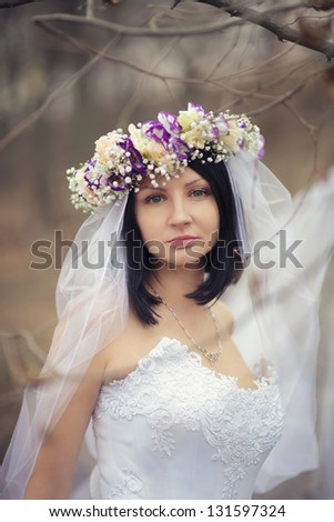 frozen bride in winter forest - stock photo