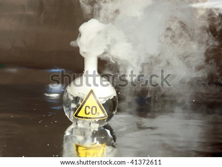 Frozen Carbon Dioxide, aka CO2 aka Dry Ice reacts violently when mixed with water, releasing CO2 into the enviroment - stock photo