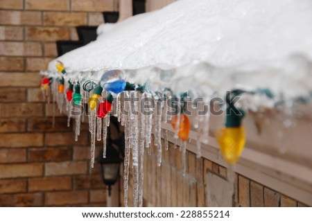 Frozen Christmas lights on the garage canopy - stock photo
