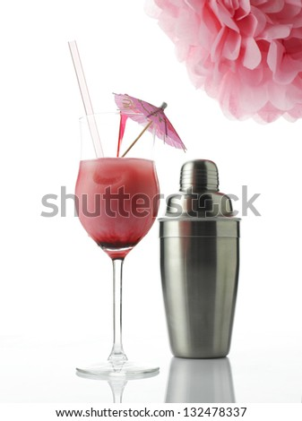 Frozen cocktail with drink umbrella and shaker. Isolated on white background.